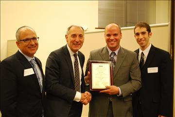 Hillel CEO Eric Fingerhut, second from left, on Oct. 10 presents the University of Illinois at Urbana-Champaign's (UIUC) Illini Hillel with a plaque celebrating its 90th anniversary. UIUC was the birthplace of the Hillel movement. Holding the plaque is Erez Cohen, director of Illini Hillel.