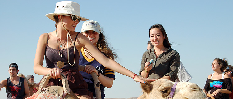 Tag-lit Birthright Camel ride.