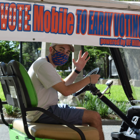Jakob Levin sits in a golf cart