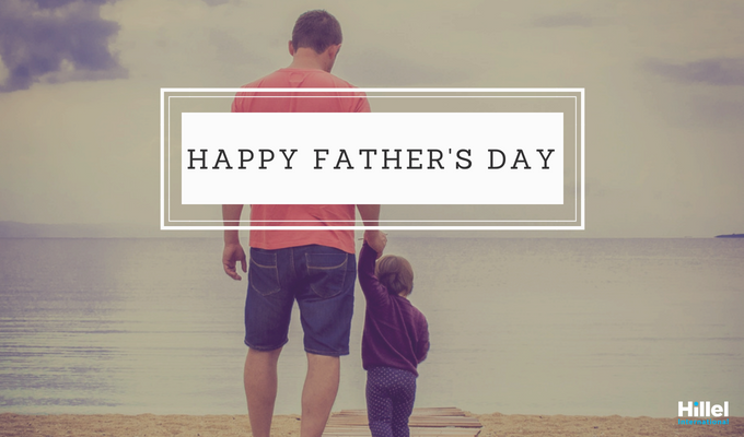 """Happy Father's Day"" with a photo of a father holding his child's hand"