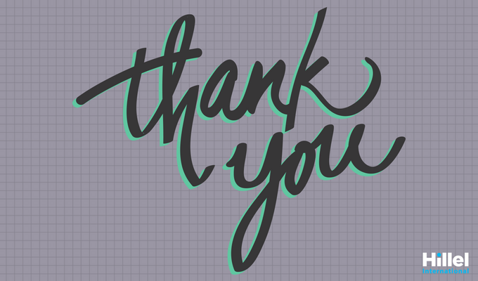 """Thank you"" in green and dark grey cursive on grey, graph paper background"