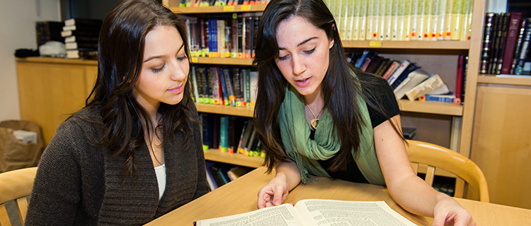 Students reading a book.