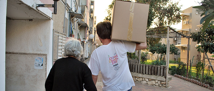 Tzedek guy helping elderly woman.